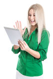 Isolated young attractive blond woman holding tablet pc. Stock Photos
