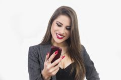 Isolated young attractive woman using smartphone Stock Image