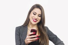Isolated young attractive woman using smartphone Stock Images