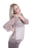 Isolated young beautiful business woman has pains on her back -. Young beautiful secretary has pains on her back isolated on white Stock Photos