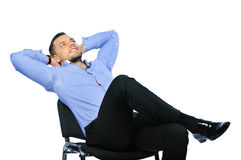 Young business man relaxing on chair Royalty Free Stock Photo