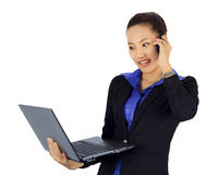 Young business woman on a cell phne with laptop compute Stock Photos