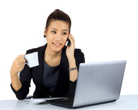 Young business woman with enjoy working expression on w Stock Photo