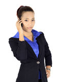 Isolated young business woman has a conversation on a mobile pho Royalty Free Stock Photo