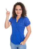 Isolated young business woman showing something with her finger. Royalty Free Stock Photos