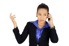 Young business woman with unhappy expression on white. Royalty Free Stock Photo