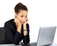 Young business woman with unhappy expression on white. Royalty Free Stock Images