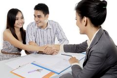 Isolated young couple making a deal Stock Photo