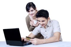 Isolated young couple online shopping Royalty Free Stock Photo