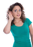 Isolated young funny woman in green listening for special sales Stock Photo