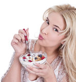 Isolated young girl eats cereals. Healthy lifestyle. Young girl eats cereals, isolated on white Royalty Free Stock Photo