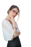Young girl with eyeglasses touching her chin Isola. Isolated young girl with eyeglasses touching her chin on white Stock Photography