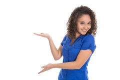 Isolated young girl presenting with hand and palm wearing blue s. Hirt over white background Royalty Free Stock Images