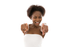 Isolated young happy african american woman pointing. Royalty Free Stock Photo