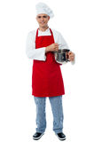 Isolated young male chef posing Royalty Free Stock Photos