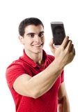 Isolated young man making selfie portrait Stock Image