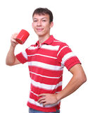 Isolated young man with red coffee cup. Isolated portrait of a young man with red coffee cup Stock Image