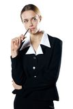 Isolated young puzzled business woman with a pen Stock Images