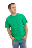 Isolated young smart man in green looking sideways on White. Young man in green looking in his future Stock Images