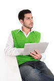 Isolated young thoughtful manager with tablet pc on white. Royalty Free Stock Photo
