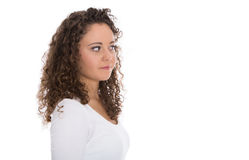 Isolated young woman with natural curls looking sideways to text Stock Photos