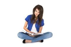 Isolated young woman with open book sitting with crossed legs. Royalty Free Stock Image