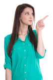 Isolated young woman is presenting or pointing with her finger. Royalty Free Stock Images