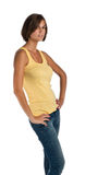 Isolated young woman in yellow top Royalty Free Stock Photography