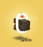 Isolated Zero calories chocolate cake on yellow background. Stock Photo