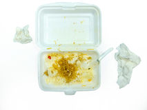 Isolates of foam boxes with scraps left over from eating and dirty tissue Royalty Free Stock Images