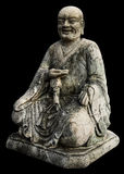 Isolates monk statues. Chinese old antique weathered a long time stock image