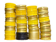 Isolates of yellow bottle caps. Royalty Free Stock Image