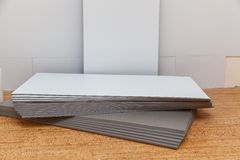 Isolating panels and building materials. Isolating panels for the economy of heat, building materials for repair of houses and apartments royalty free stock photo