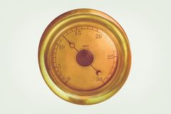 Isolation of an Antique Brass Gauge. Isolated Close Up of a Brass Vintage Measurement Gauge Royalty Free Stock Photo