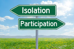 Isolation or Participation. Two green direction signs - Isolation or Participation Stock Photo