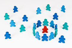Isolation or Segregation. Social and Business concepts illustrated with colorful wooden people Stock Image