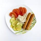 Isolationsschlauch, Tomatekohl, Wurst Stockbild