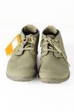 Isolatmäns känga och skor Arkivbilder