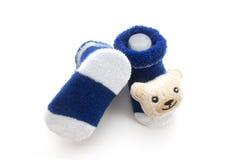 Isolato dei calzini del bambino blu Immagine Stock
