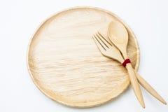 Isolato di legno del piatto, del cucchiaio e della forchetta Immagine Stock Libera da Diritti
