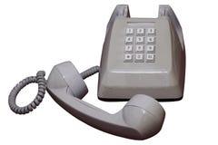 Isolato su bianco ha sollevato il vecchio telefono di modello dello scrittorio con il percorso di ritaglio Immagine Stock Libera da Diritti
