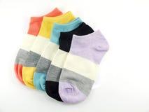 Isolato variopinto dei calzini su fondo bianco Fotografia Stock Libera da Diritti