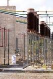 Isolators in high voltage installation. Ceramic brown isolators in high voltage park Royalty Free Stock Image