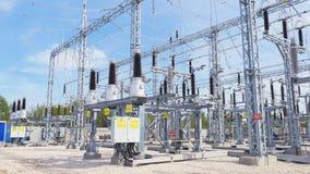 Isolators installed at transmission substation distributing energy. Ceramic isolators installed among electric equipment at transmission substation distributing stock footage