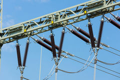 Isolators. Of a transformer station in front of a blue sky Stock Photo