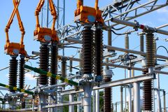 Isolators and transformers at the electrical substation. Electrical equipment Royalty Free Stock Image