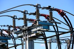 Isolators and transformers at the electrical substation. Electrical equipment Royalty Free Stock Photography