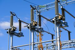 Isolators and transformers at the electrical substation. Electrical equipment Stock Photo