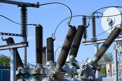 Isolators and transformers at the electrical substation. Electrical equipment Stock Photography