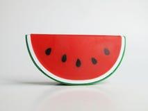Isoleer cijfer de leuke plastic watermeloensteun model decore Stock Foto